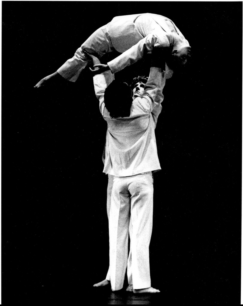 2 men lift dancers in arch (side view)72