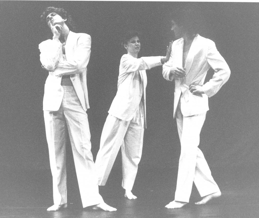 3 dancers stand around in suits72