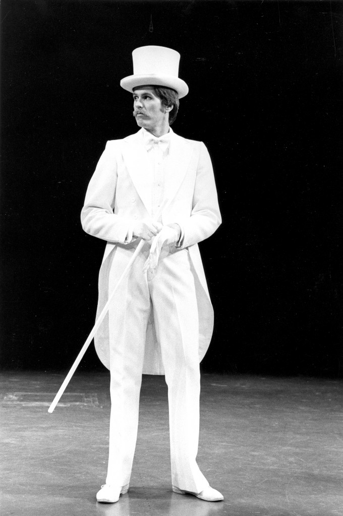 Brook in top hat puts on gloves72.
